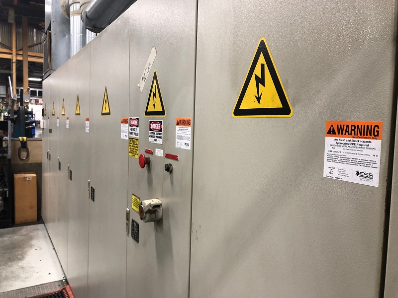 Arc flash electrical panels with warning labels